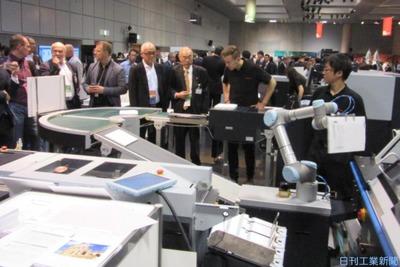 ニュース拡大鏡/スマート印刷工場に脚光 製本ライン、ロボで省人化